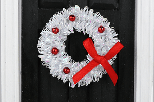 White Tinsel Wreath with Red Accents