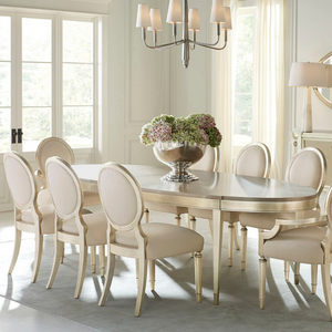 A House Favorite Oval Dining Table in Gold - HER Home Design