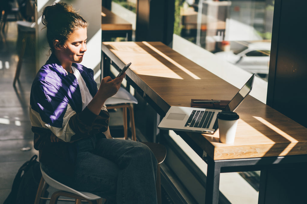 Woman with laptop and coffee in a cafe