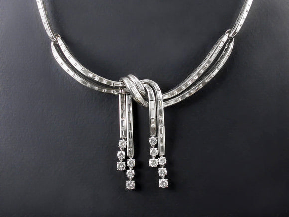A platinum and diamond necklace, in the shape of a knot. 1950