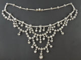 A XIX Century silver topped, Yellow gold and old-cut diamond necklace of draperie design.