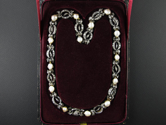 A Victorian XIX Century silver topped, Yellow gold, old-cut diamond and natural pearl necklace.