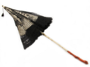 An antique  ivory and carved coral parasol. Southern Italy. 1860.