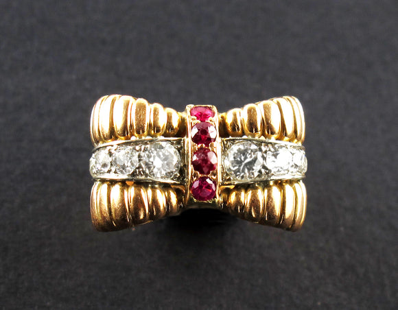 A yellow gold, diamond and ruby ring.
