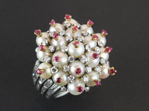 A platinum diamond, pearl and ruby cocktail ring. 1960 circa