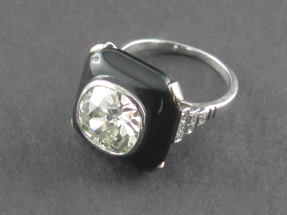 Art Déco platinum diamond and onyx ring.