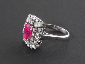 A classical platinum and diamond ring, centering a beautiful Burma ruby, weighting 3.52 with a gemological certificate stating that is of Myanmar (Burma) origin with no indication of heating. 1950 c.a.