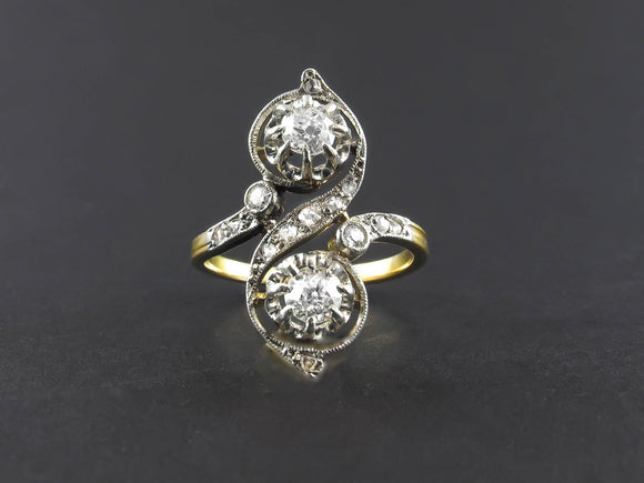 Edwardian platinum, gold and diamond toi et moi ring