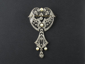 An Edwardian platinum, yellow gold, diamond and natural pearl brooch and pendant