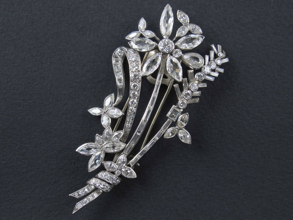 An Art Déco platinum and diamond brooch in the shape of a flower branch. Kutchinsky, London 1830 circa