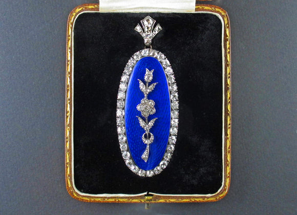A Victorian XIX Century gold, silver and old-cut diamond pendant. Of flower design with blue guilloche enamel. 1850 c.a.