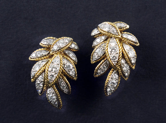 A pair Van cleef and Arpels gold and diamond earrings, 1960 c.a.