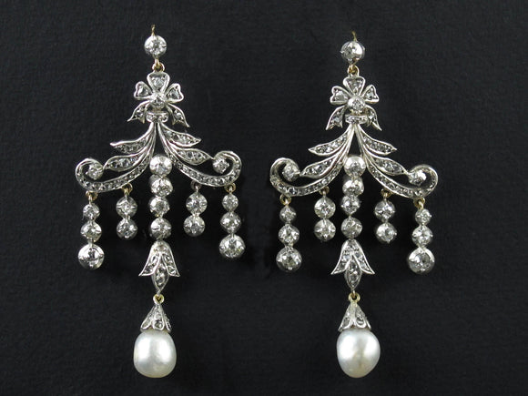 A pair of silver topped, Yellow gold and old-cut diamond chandelier earrings with two natural pearls. Late 19th century.