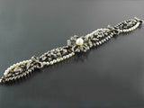 A beautiful silver topped, Yellow gold, old-cut diamond and natural pearl bracelet. France, XIX Century.