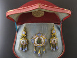 A XIX Century very fine gold and micromosaic demi-parure.