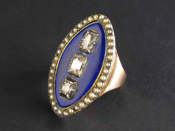 A Georgian XIX Century gold, table-cut diamond and blue enamel marquise ring