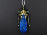 A rare Art Déco gold, platinum, jade and lapis pendant.