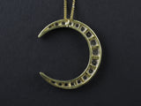 A silver topped, Yellow gold and old-cut diamond crescent moon pendant and brooch