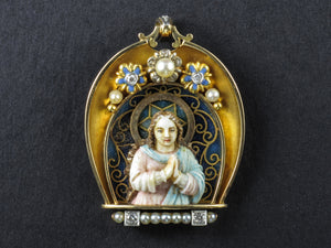 An Art Déco platinum, yellow gold, diamonds, plique a jour enamel, natural pearls and ivory Virgin Mary pendant.