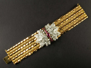 A yellow gold, diamond and rubies bracelet. Period 1945 circa