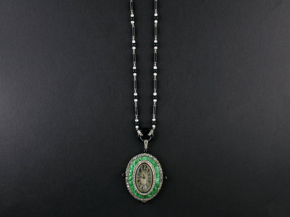 An Art Déco platinum, diamonds, natural pearls, onyx and jade pendant-watch