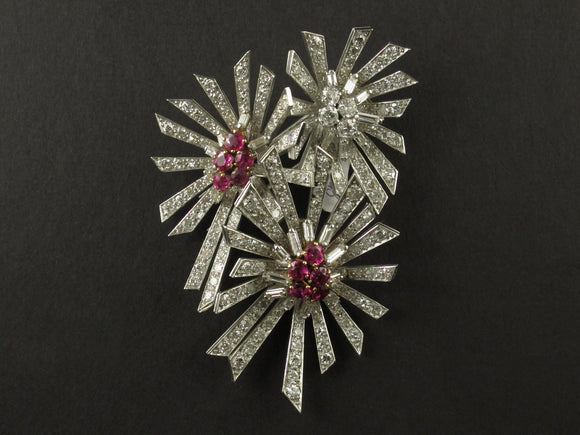 A platinum diamond and ruby brooch. 1940.