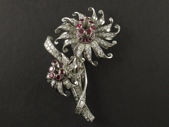 A platinum diamond and ruby brooch depicting two flowers. 1940.