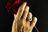 An Art Déco platinum, diamond and Emerald ring