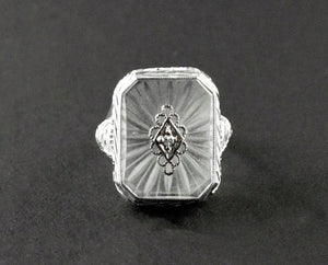 An Art Déco white gold, rock crystal and diamond ring