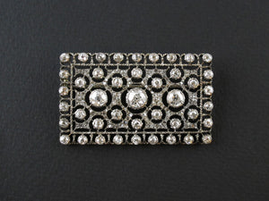 An Art Déco Mario Buccellati silver topped, yellow gold and old cut diamond plaque brooch. 1930 c.a. cm 5x3. Original fitted box