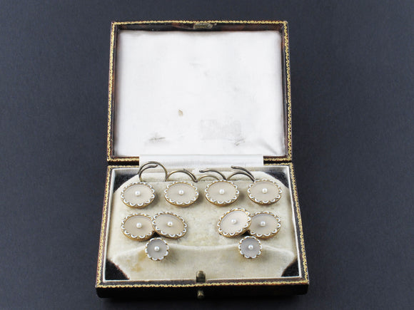 Art Déco yellow gold, enamel, rock crystal and pearls buttons and cufflinks set in original box.