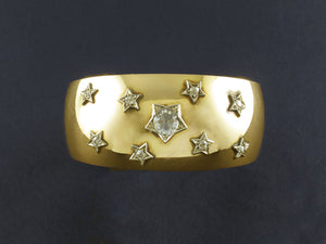 A yellow gold cuff bracelet with diamond stars. Italy 1940