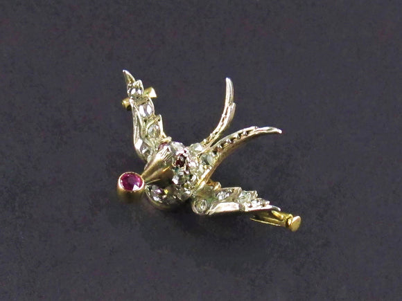 A XIX Century yellow gold, silver, rose cut diamond and rubies swallow brooch