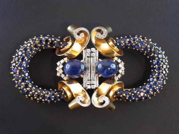 A very rare double clip brooch in Yellow gold and platinum with old-cut diamonds and sapphires. Marchak, 1940 c.a.