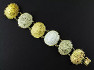 A 14 carats Yellow gold bracelet with 6 lava cameos. Naples, XIX Century.