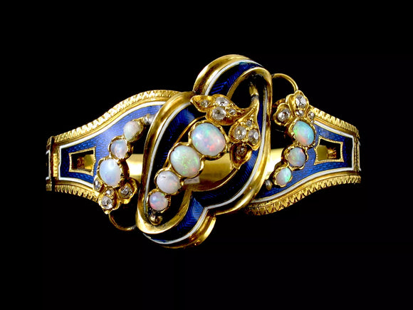 A yellow gold bangle with old-cut diamonds, opals and blue enamel. Chaumet, Paris, around 1860.