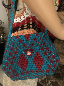 Pretty blue red colored crystals like beads all over purse