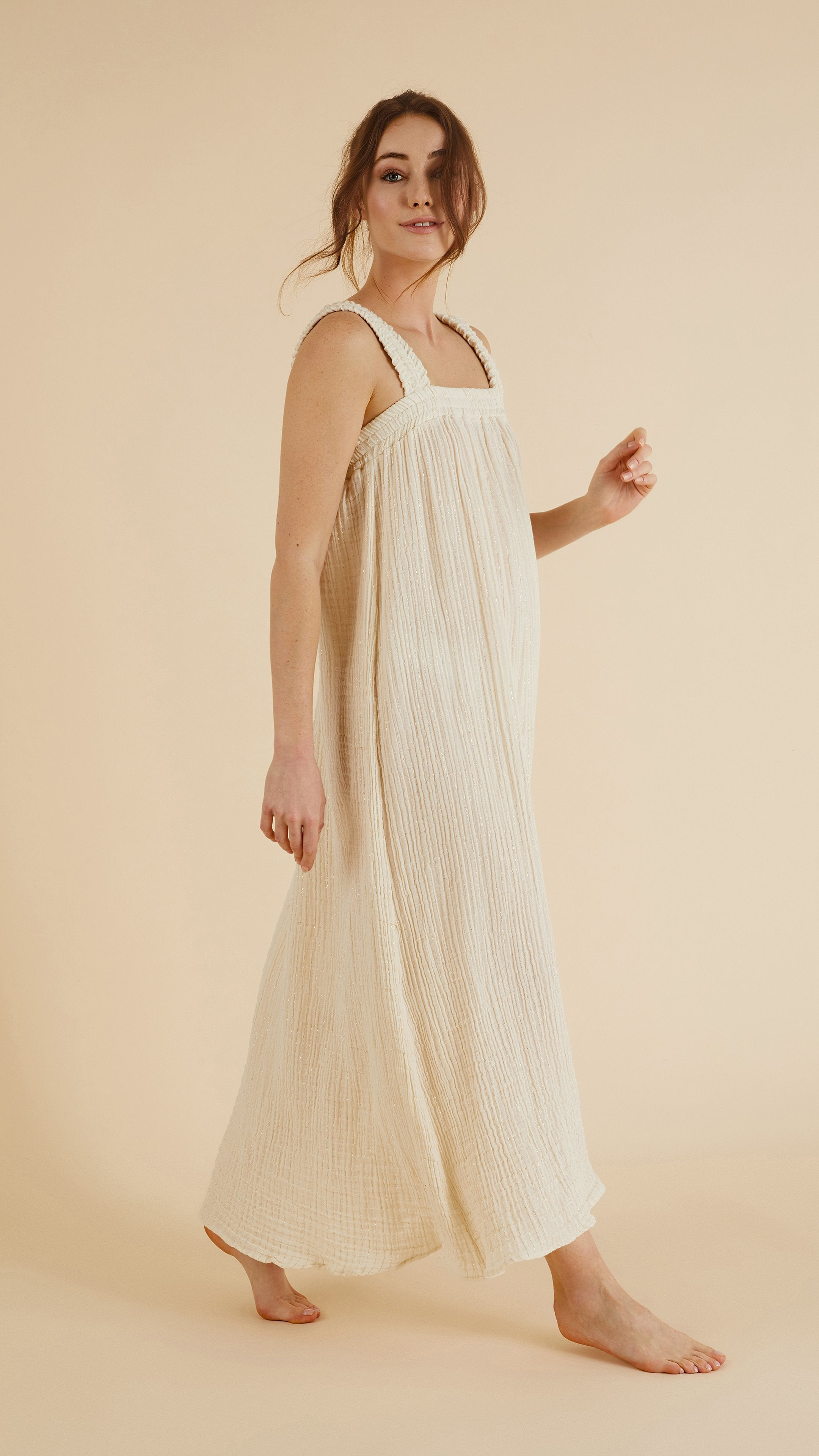 Side profile -  Noa Straps Maxi Dress in Natural with Gold Stripes