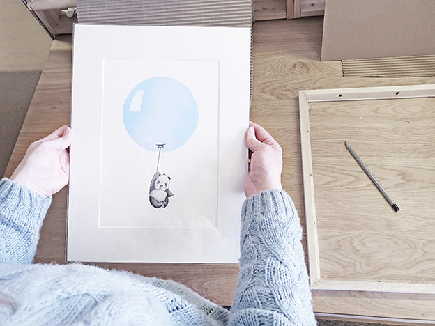 framing a children's pastel blue balloon nursery print