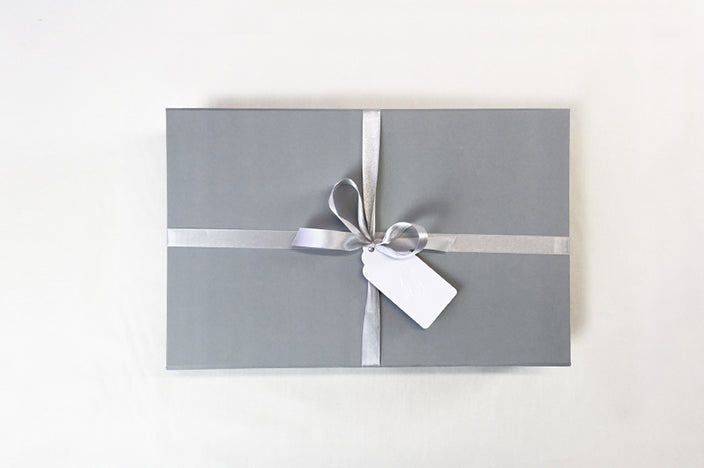 soft grey luxury gift box with satin bow