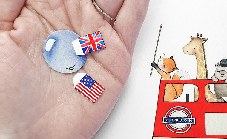 hand holding printed paper uk and usa flags