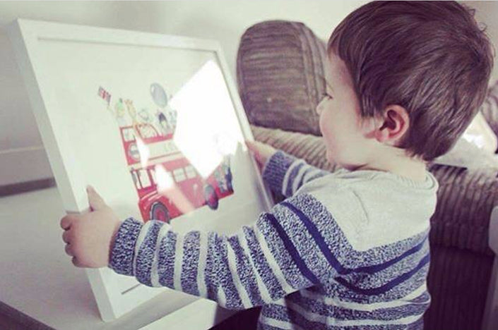 boy with his framed London bus picture