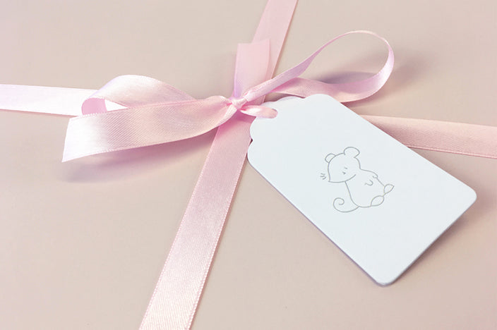 blush pink luxury gift box with satin ribbon and gift tag