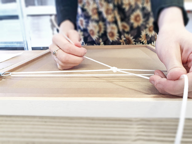 attaching picture cord to a frame