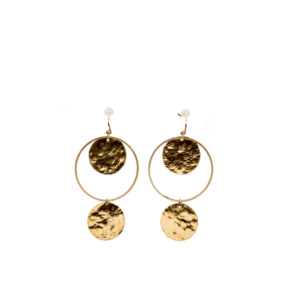 Brass hoop earrings with dangling medallions.