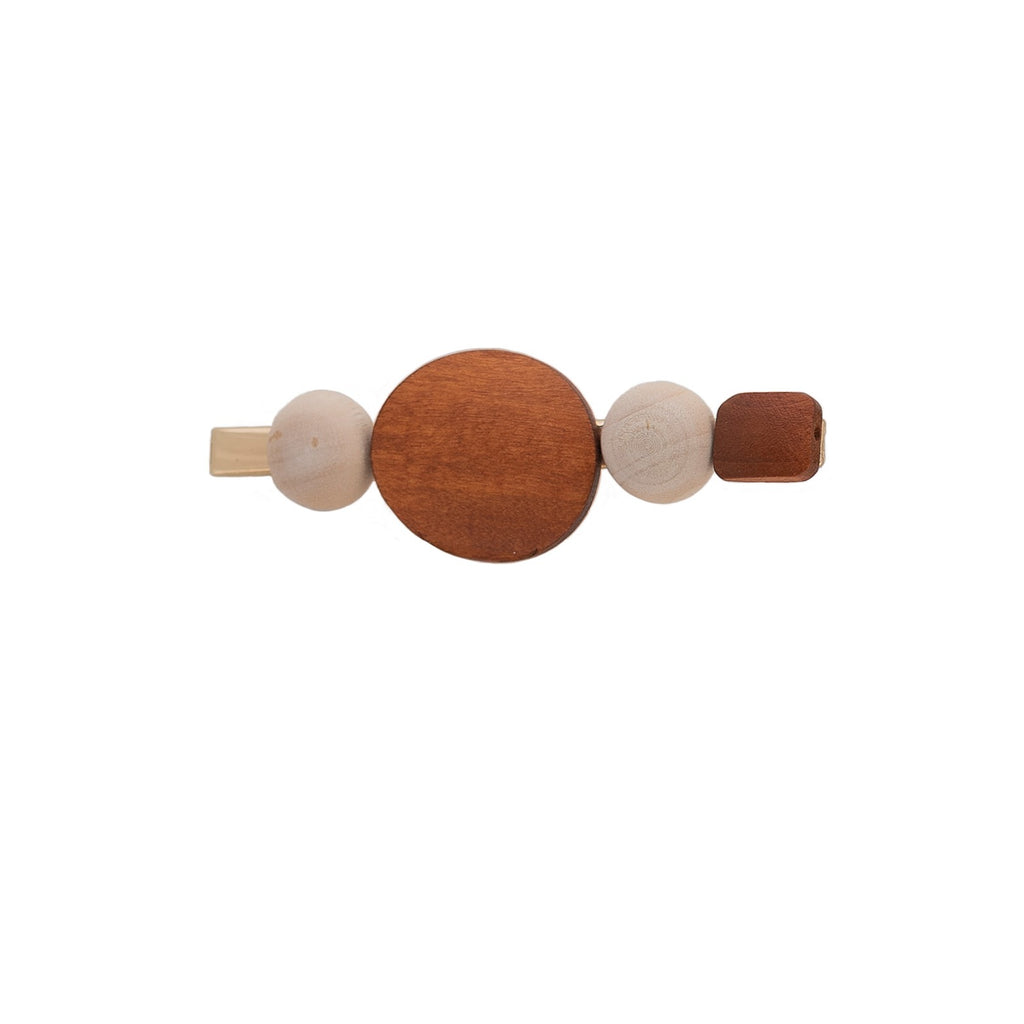 Stained wood hair clip with brown and and beige circles in a row