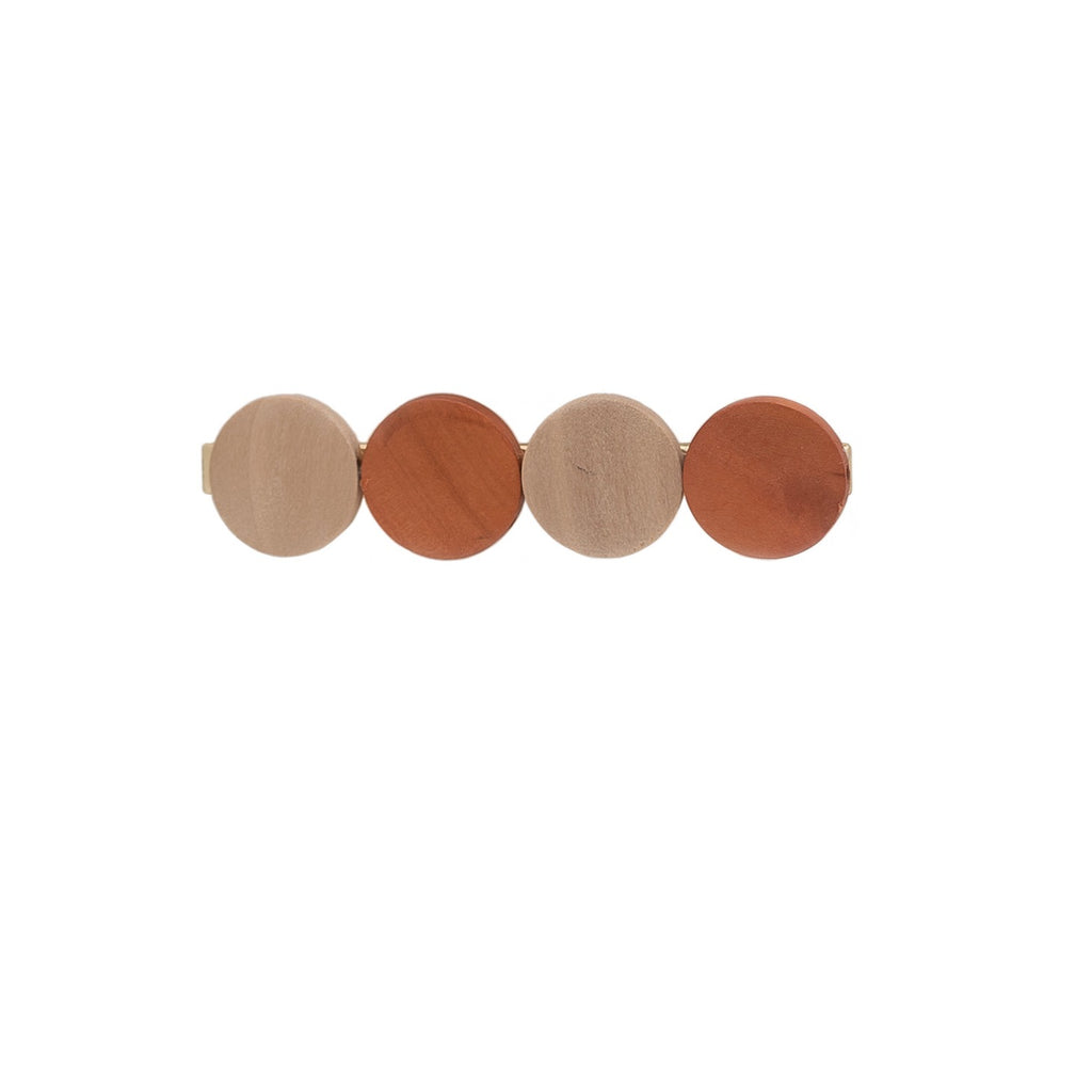beige and brown wooden circles on hair clip