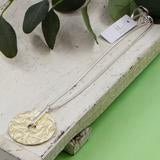 Textured disc pendant on snake chain necklace