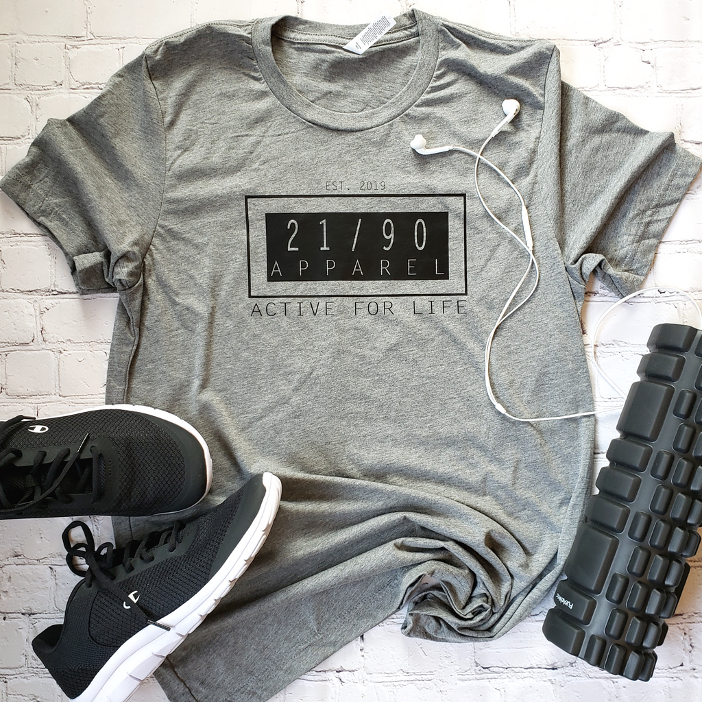 grey unisex t shirt with 21/90 apparel logo and foam roller, running  shoes, ear buds