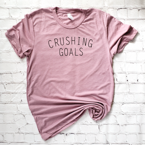 flatlay of pink unisex triblend crushing goals t shirt